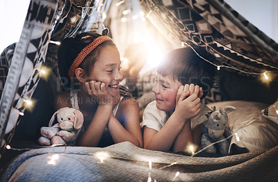 Buy stock photo Cropped shot of two adorable young kids lying in their blanket fort at home