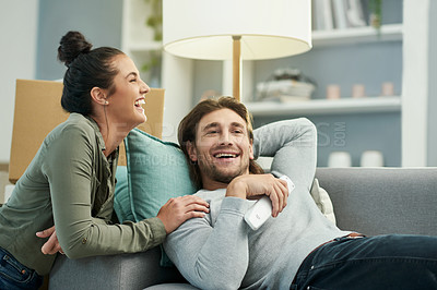 Buy stock photo Cropped shot of a young attractive couple in their new home