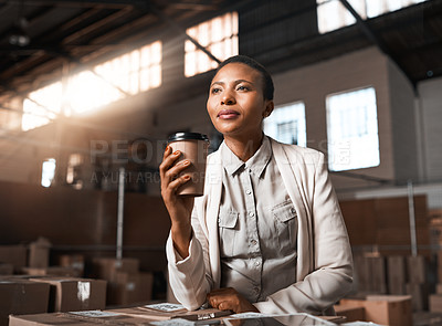 Buy stock photo Shot of a factory manager drinking coffee in a warehouse