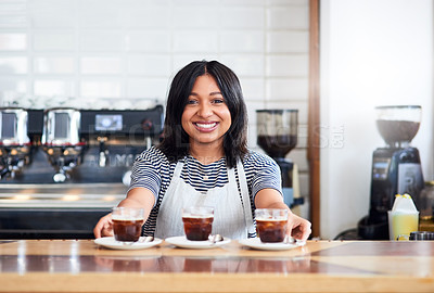 Buy stock photo Shot of a barista serving beverages in a coffee shop