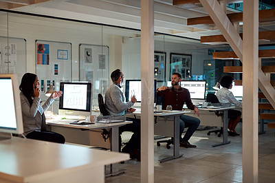 Buy stock photo Full length shot of a group of businesspeople working at their desks in the office