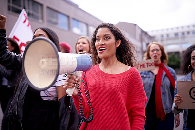 Buy stock photo Cropped shot of women protesting in the city