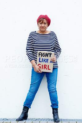 Buy stock photo Shot of a mature woman holding a poster that reads