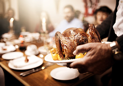 Buy stock photo Cropped shot of an unrecognizable person serving a roasted turkey at Christmas lunch