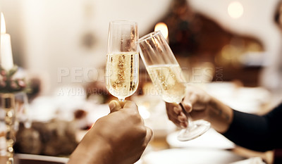 Buy stock photo Cropped shot of people making a toast over Christmas lunch