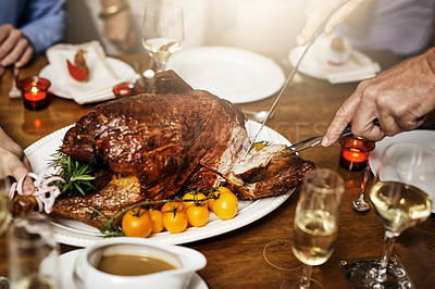 Buy stock photo Cropped shot of an unrecognizable person cutting into a turkey at Christmas lunch