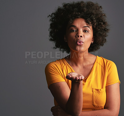 Buy stock photo Studio shot of a beautiful young woman blowing kisses