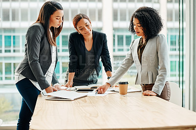 Buy stock photo Cropped shot of young businesswomen having a meeting in the convention centre