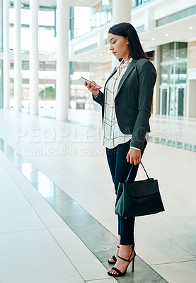 Buy stock photo Shot of a young beautiful businesswoman using a cellphone in the convention centre