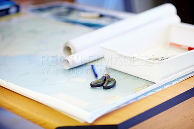Buy stock photo High angle shot of a map and stationary lying on a desk inside a lifeguard office