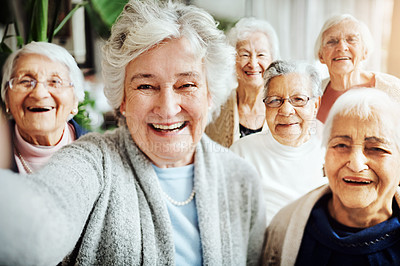 Buy stock photo Portrait of a group of senior women taking a selfie together at a retirement home