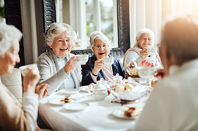 Buy stock photo Shot of happy senior women having tea together at a retirement home