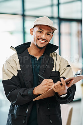 Buy stock photo Portrait of a courier using a clipboard