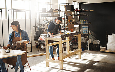 Buy stock photo Cropped shot of two attractive young creative female artisans working in their workshop