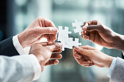 Buy stock photo Closeup shot of a group of unrecognizable businesspeople holding puzzle pieces together