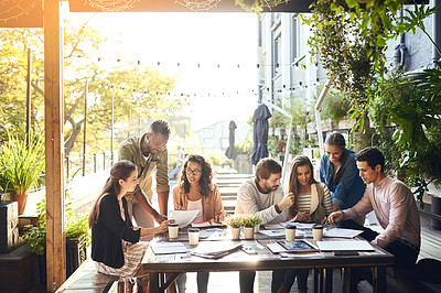 Buy stock photo Cropped shot of a group of colleagues having a meeting outside at a cafe