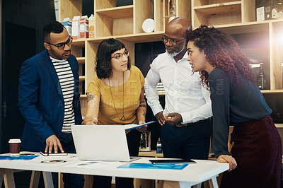 Buy stock photo Shot of a group of designers having a discussion in a modern office