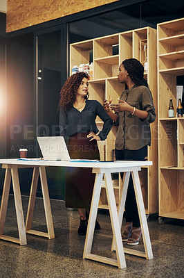 Buy stock photo Shot of two businesswomen having a discussion at the office