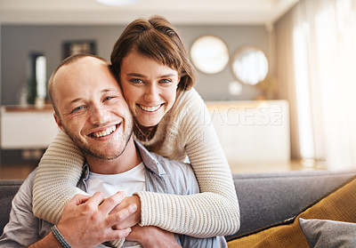 Buy stock photo Portrait of an affectionate young couple spending quality time together at home