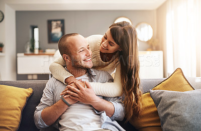 Buy stock photo Shot of an affectionate young couple spending quality time together at home