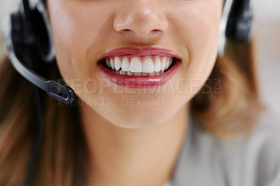 Buy stock photo Closeup shot of an unrecognizable young female call center agent working in an office