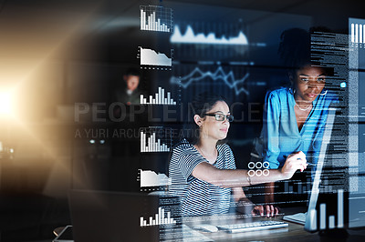 Buy stock photo Shot of two programmers working together on a computer code at night