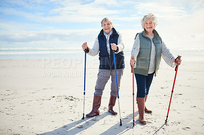 Buy stock photo Portrait of two senior women going for a walk along the beach