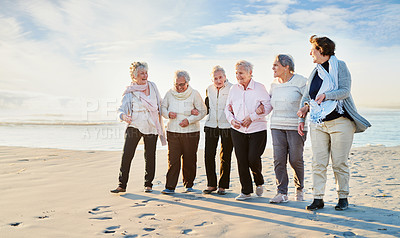 Buy stock photo Shot of a group of senior women going for a walk along the beach