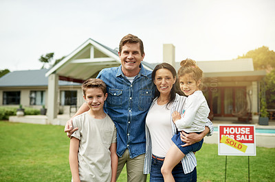 Buy stock photo Portrait of a family of four standing in front of their new home