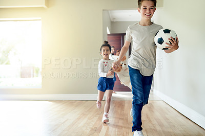 Buy stock photo Shot of two young kids running into their new house