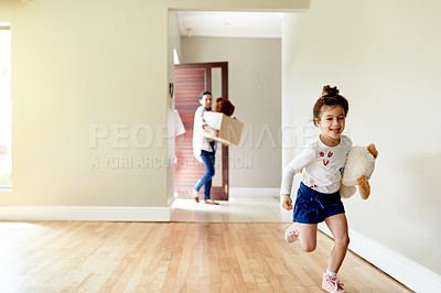 Buy stock photo Shot of a little girl running ahead to see her new room