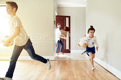 Buy stock photo Shot of a little girl and boy running off to their new rooms