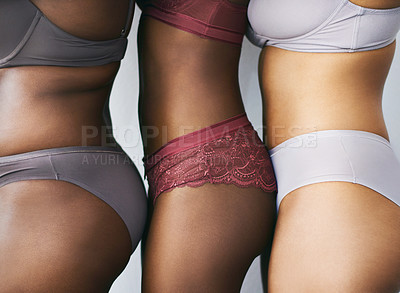 Buy stock photo Cropped studio shot of a group of beautiful young women posing together in their underwear