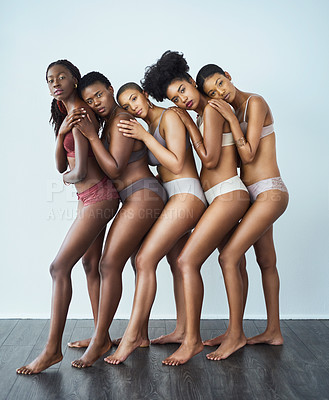 Buy stock photo Studio shot of a group of beautiful young women posing together in their underwear