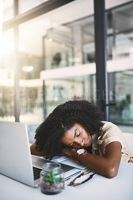 Buy stock photo Shot of a happy young businesswoman sleeping at her desk in a modern office