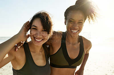 Buy stock photo Cropped portrait of two attractive and athletic young women out for a run on the beach