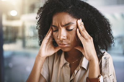 Buy stock photo Shot of a young businesswoman looking stressed at work