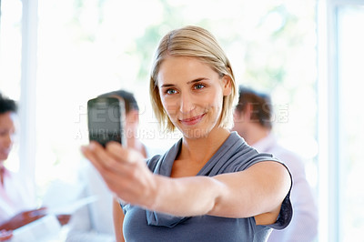 Buy stock photo Happy woman taking self portrait with phone camera