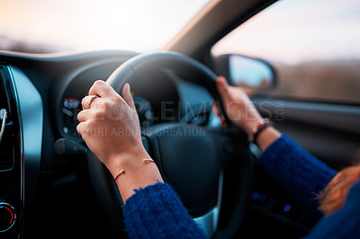 Buy stock photo Cropped shot of a woman driving a car