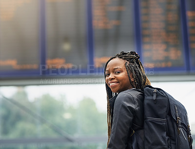 Buy stock photo Portrait of a young woman reading an information display in a transport facility