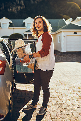 Buy stock photo Full length portrait of a handsome young man packing his car before leaving on a roadtrip
