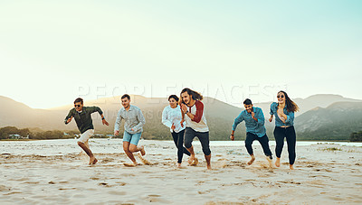 Buy stock photo Full length shot of a group of young friends running out on the beach