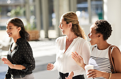Buy stock photo Cropped shot of a group of businesswomen walking and talking at the convention centre