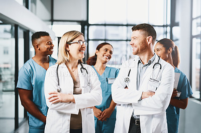 Buy stock photo Shot of a group of medical practitioners standing together in a hospital