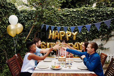 Buy stock photo Cropped shot of a group of friends toasting while celebrating a birthday outdoors