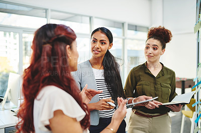 Buy stock photo Shot of a group of businesswomen having a discussion in an office