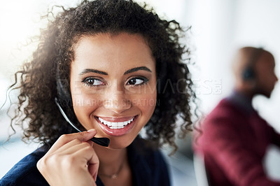 Buy stock photo Cropped shot of an attractive young female call center agent looking thoughtful while working in her office