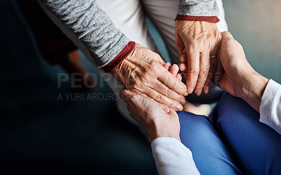 Buy stock photo Cropped shot of a nurse holding a senior woman's hands in a retirement home