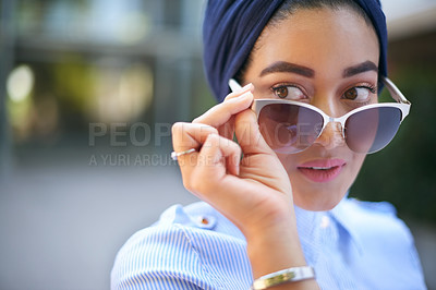 Buy stock photo Cropped shot of an attractive young woman in glasses standing outside the mall