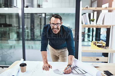 Buy stock photo Shot of a mature male architect working on a design in his office